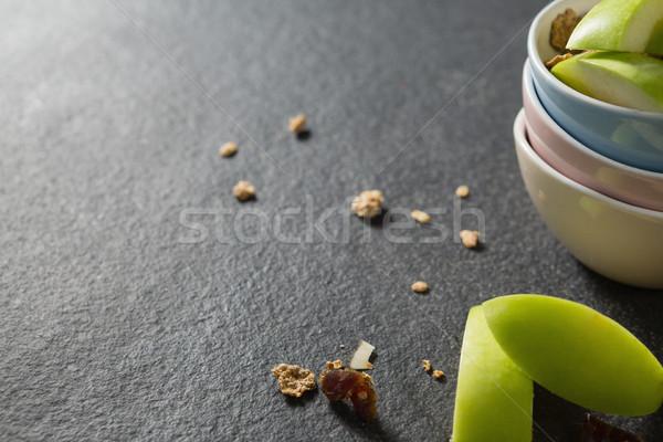 Tálak reggeli gabonafélék gyümölcsök fekete közelkép Stock fotó © wavebreak_media