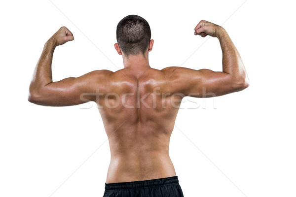 Rear view of shirtless athlete flexing muscles Stock photo © wavebreak_media