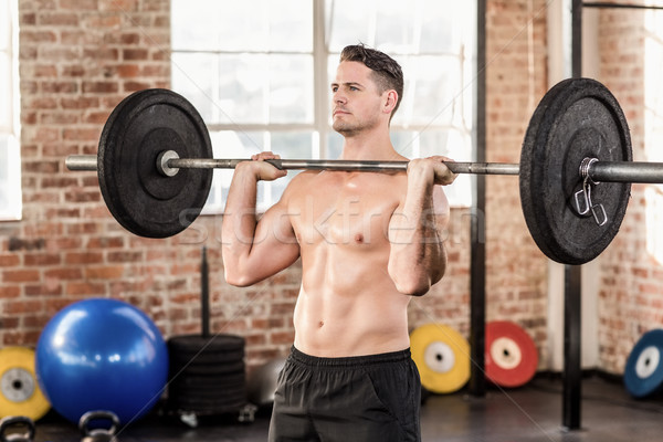 Muscular serious man doing weightlifting Stock photo © wavebreak_media