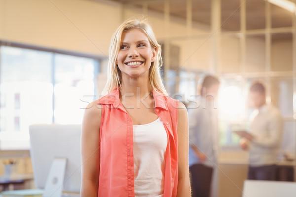 Empresária em pé masculino colega sorridente Foto stock © wavebreak_media