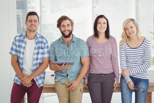 Portrait of smiling business people with digital tablet  Stock photo © wavebreak_media