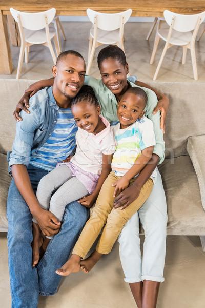 Glückliche Familie entspannenden Couch Wohnzimmer glücklich home Stock foto © wavebreak_media