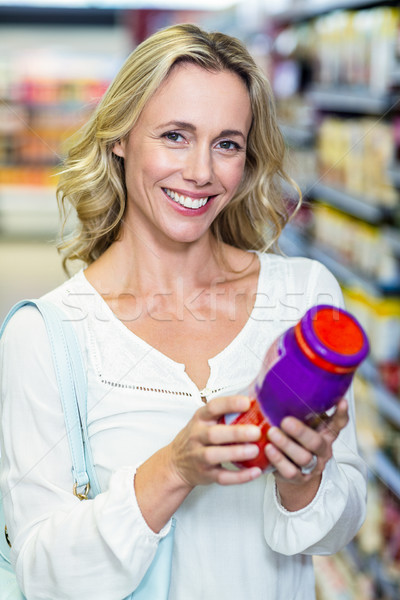 Woman reading nutritional values Stock photo © wavebreak_media