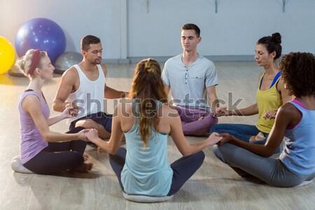 Ioga instrutor estudantes meditando oração posição Foto stock © wavebreak_media