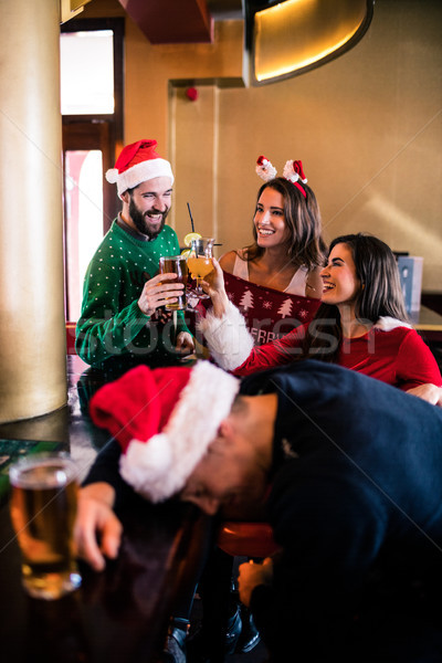 Festive friends drinking beer and cocktail Stock photo © wavebreak_media