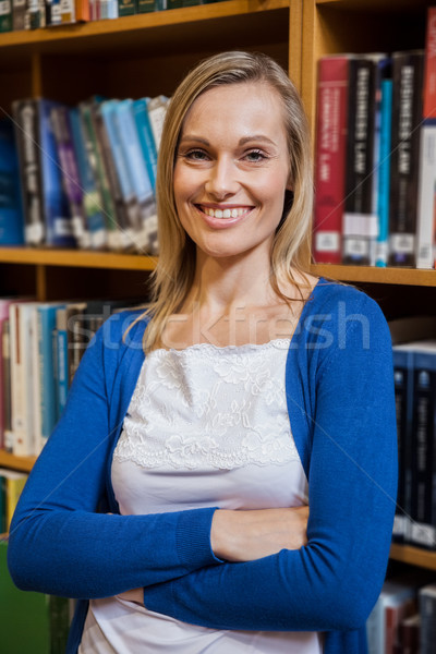 Smiling female student with arms crossed in the library Stock photo © wavebreak_media