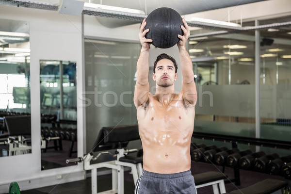 Shirtless man exercising with medicine ball Stock photo © wavebreak_media