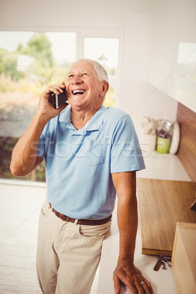 Smiling senior man on a phone call Stock photo © wavebreak_media