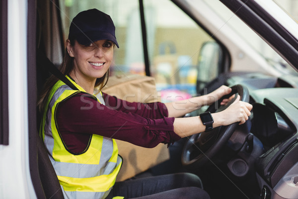 Delivery driver driving van with parcels on seat Stock photo © wavebreak_media