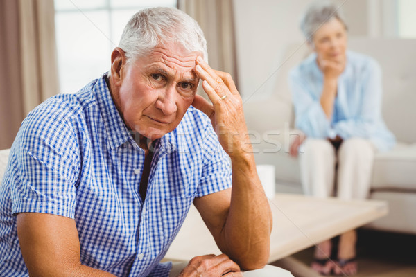 Worried senior man sitting on sofa Stock photo © wavebreak_media