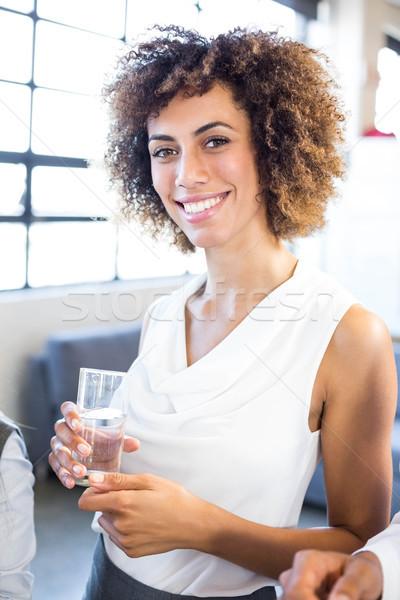 üzletasszony üveg víz portré iroda üzlet Stock fotó © wavebreak_media