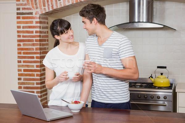 Young couple having coffee in kitchen Stock photo © wavebreak_media