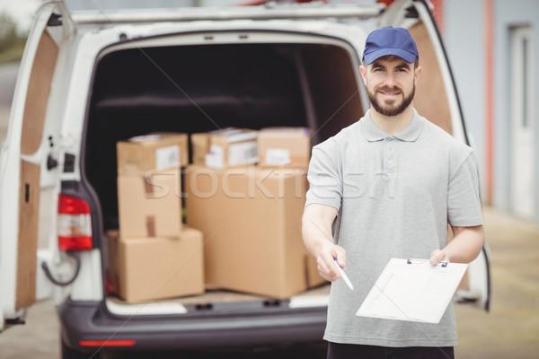 Delivery man holding clipboard Stock photo © wavebreak_media