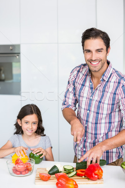 Portrait of smiling father cutting zucchini with daughter  Stock photo © wavebreak_media