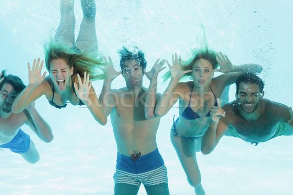 Gruppo giovani amici subacquea piscina Foto d'archivio © wavebreak_media