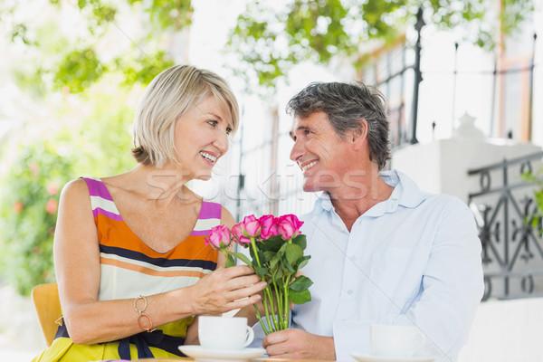 Happy couple sitting at cafe Stock photo © wavebreak_media