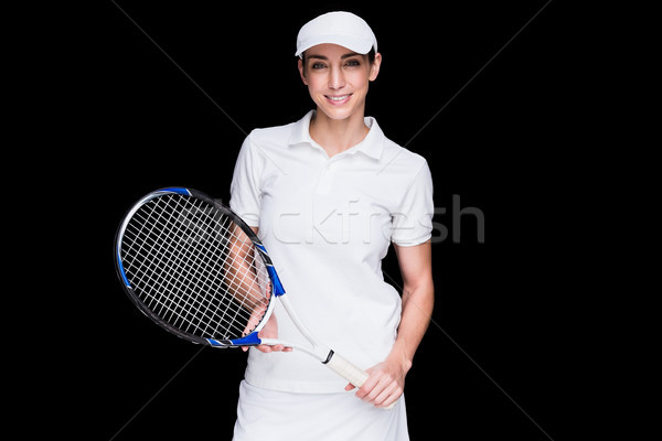 Female athlete posing with tennis racket Stock photo © wavebreak_media