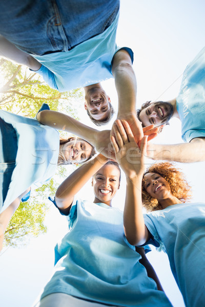 Portrait of volunteer group forming huddles Stock photo © wavebreak_media