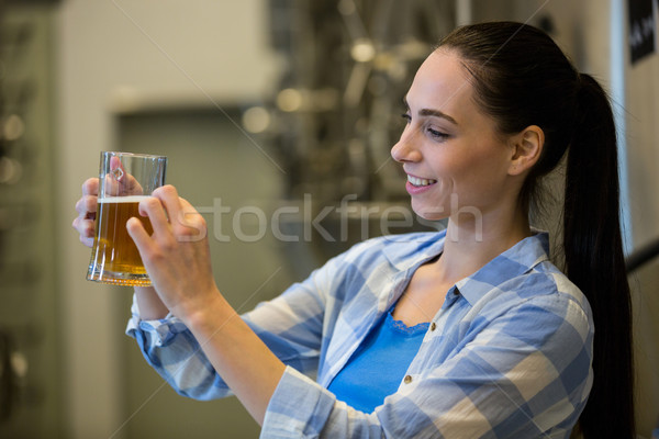 Close-up of female brewer testing beer Stock photo © wavebreak_media