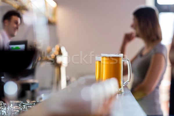 Beer mugs on bar counter at restaurant Stock photo © wavebreak_media