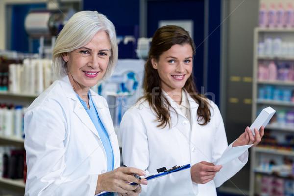 Pharmacists checking and writing prescription for medicine in ph Stock photo © wavebreak_media
