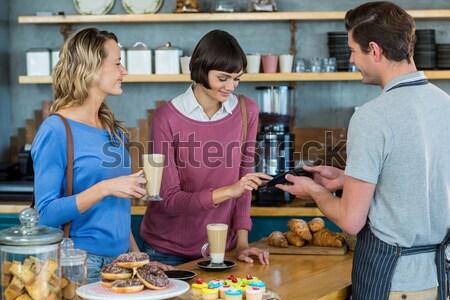 Klant betaling counter vrouw technologie Stockfoto © wavebreak_media