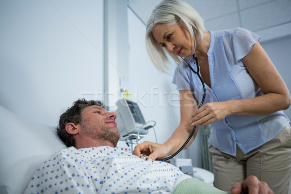 Doctor examining a patient with a stethoscope Stock photo © wavebreak_media