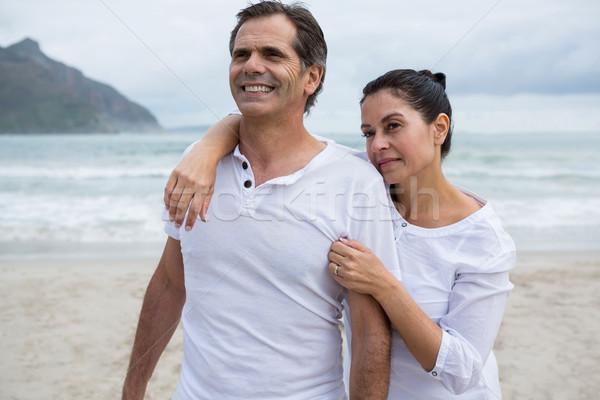 Romantic couple standing on beach Stock photo © wavebreak_media