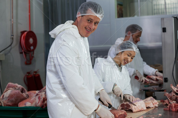 Butchers cutting meat at meat factory Stock photo © wavebreak_media
