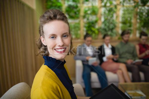 Działalności wykonawczej uśmiechnięty posiedzenia biuro lobby Zdjęcia stock © wavebreak_media