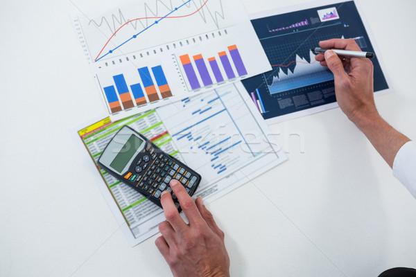 Manos gráfico blanco negocios papel pluma Foto stock © wavebreak_media