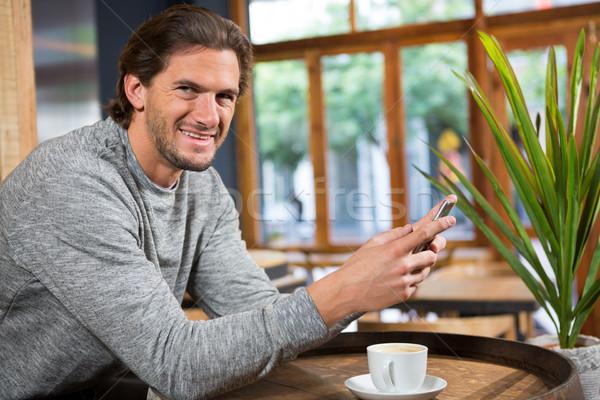 Sonriendo hombre hablar Cafetería café Foto stock © wavebreak_media