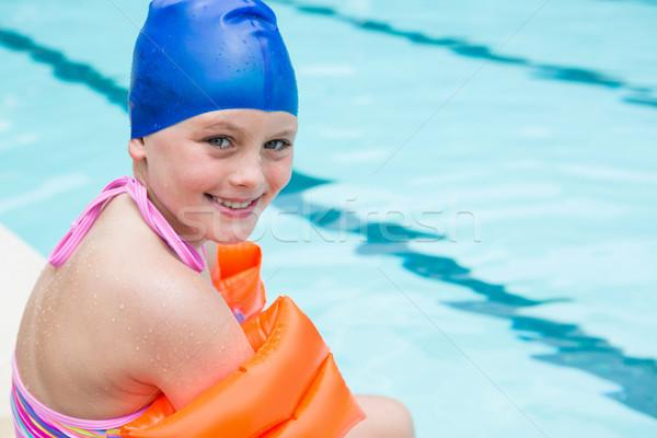 Sorridente menina nadar boné sessão água Foto stock © wavebreak_media