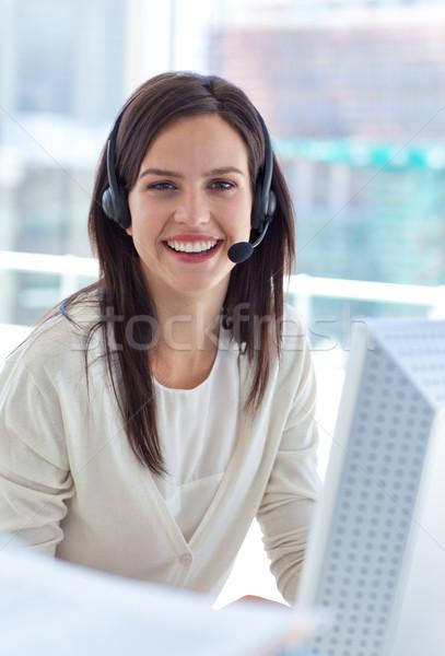 Ritratto sorridere imprenditrice lavoro call center auricolare Foto d'archivio © wavebreak_media