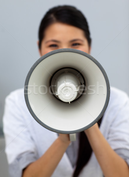 Self-assured businesswoman shouting instructions  Stock photo © wavebreak_media