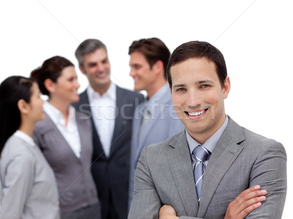 Positive businessman with folded arms standing with his team Stock photo © wavebreak_media