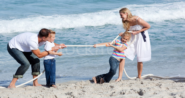 Lively family playing tug of war  Stock photo © wavebreak_media