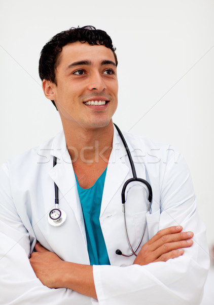 Attractive male doctor smiling at camera Stock photo © wavebreak_media