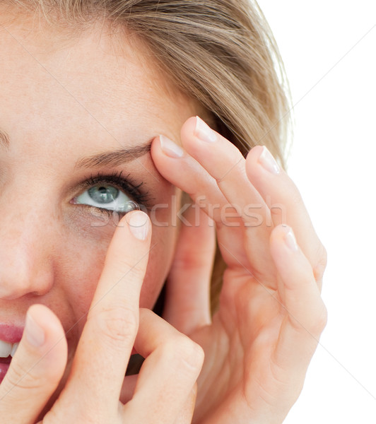 Close-up of a woman putting a contact lens  Stock photo © wavebreak_media