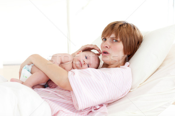 Mother embracing her newborn baby Stock photo © wavebreak_media