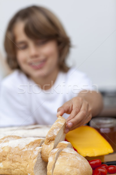 Smiling child taking a piece of bread Stock photo © wavebreak_media