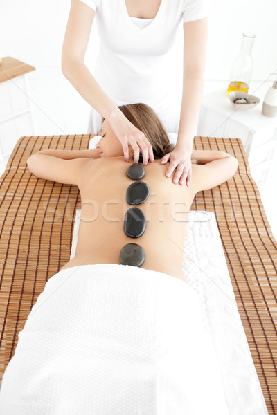 Delighted woman having a massage Stock photo © wavebreak_media