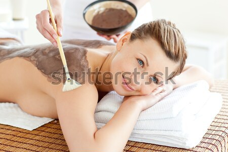 Relaxed woman enjoying a mud skin treatment Stock photo © wavebreak_media