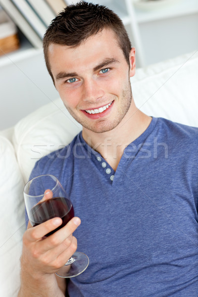Sorridere giovane vetro vino guardando Foto d'archivio © wavebreak_media