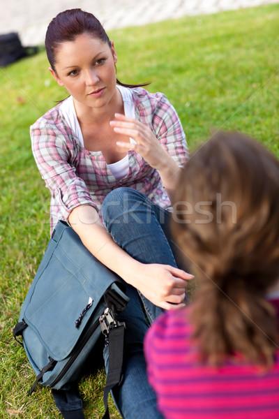Kettő női barátok beszél együtt ül Stock fotó © wavebreak_media
