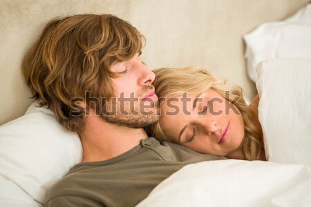 Stock photo: Portrait of a baby and his mother sleeping peacefully in the sofa at home