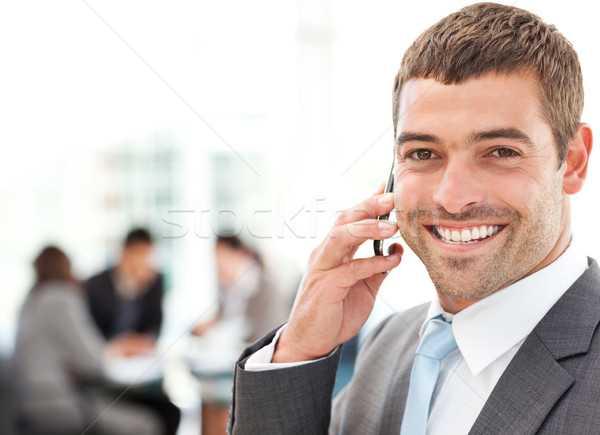 Handsome businessman on the phone in the foreground Stock photo © wavebreak_media