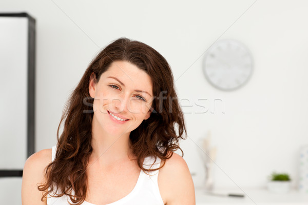 Portrait of a radiant woman in pyjama in her kitchen at home Stock photo © wavebreak_media