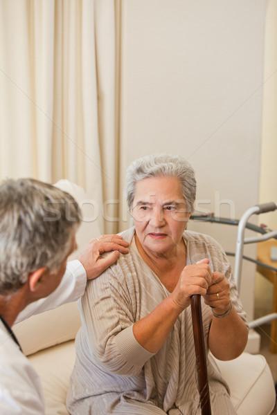 Senior médico falante paciente mãos idoso Foto stock © wavebreak_media
