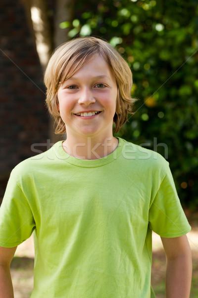 Little boy looking at the camera in the garden Stock photo © wavebreak_media